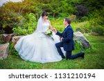 beautiful bride with bouquet of ... | Shutterstock . vector #1131210194