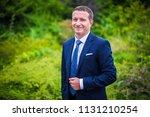 happy groom in suit with tie on ... | Shutterstock . vector #1131210254