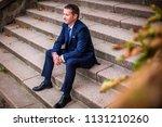 elegant man in suit and tie... | Shutterstock . vector #1131210260