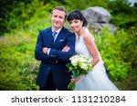 portrait of happy newlyweds in... | Shutterstock . vector #1131210284