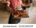closeup of a waiter standing in ... | Shutterstock . vector #1131220139