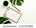 clipboard and white paper on... | Shutterstock . vector #1131223283