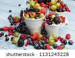 various fresh summer berries.... | Shutterstock . vector #1131245228