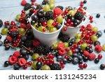 various fresh summer berries.... | Shutterstock . vector #1131245234