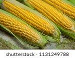 fresh corn on cobs on rustic... | Shutterstock . vector #1131249788