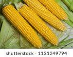 fresh corn on cobs on rustic... | Shutterstock . vector #1131249794
