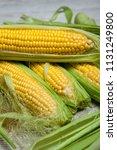 fresh corn on cobs on rustic... | Shutterstock . vector #1131249800