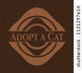 adopt a cat wood emblem.... | Shutterstock .eps vector #1131297614