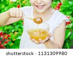 the child eats honey. selective ... | Shutterstock . vector #1131309980