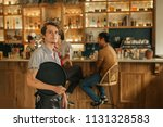 portrait of a young waiter... | Shutterstock . vector #1131328583