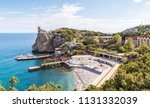 Small photo of Panorama of the Black Sea coast of Crimea with the castle of Swallow's Nest, Russia. It is a landmark of Crimea. Scenic panoramic view of Crimea resort. Amazing Swallow's Nest above abyss in summer.