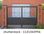swing gates with wrought iron... | Shutterstock . vector #1131363956