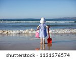 baby girl playing at summer...   Shutterstock . vector #1131376574