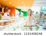 woman shopping in a supermarket   Shutterstock . vector #1131408248