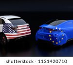 two cars with eu and us flags... | Shutterstock . vector #1131420710