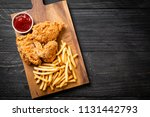 fried chicken with french fries ... | Shutterstock . vector #1131442793