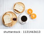 cup of black coffee with bread... | Shutterstock . vector #1131463613