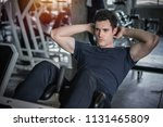 handsome man exercising doing... | Shutterstock . vector #1131465809