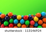 many gumballs isolated on green background - stock photo