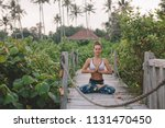 young woman meditate in lotus... | Shutterstock . vector #1131470450