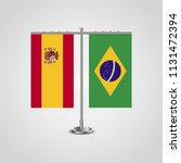 table stand with flags of spain ... | Shutterstock .eps vector #1131472394