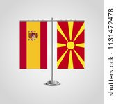 table stand with flags of spain ... | Shutterstock .eps vector #1131472478