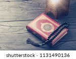 holy book quran with rosary | Shutterstock . vector #1131490136