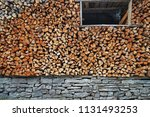 Stack Of Wood Logs And Dry...