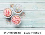 sweet cupcakes with colorful... | Shutterstock . vector #1131495596