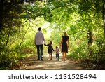 happy young family in nature | Shutterstock . vector #1131528494