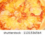 hot pizza slice with melting... | Shutterstock . vector #1131536564