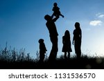 silhouette of a happy family... | Shutterstock . vector #1131536570