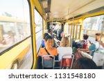 tram inside. passengers in... | Shutterstock . vector #1131548180