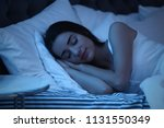 young woman sleeping in bed at... | Shutterstock . vector #1131550349