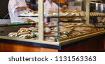 croissant with ham and cheese....   Shutterstock . vector #1131563363