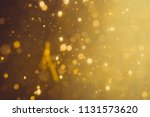 dark abstract gold bokeh... | Shutterstock . vector #1131573620