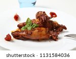 stuffed squid with tomato | Shutterstock . vector #1131584036