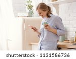 young woman using smartphone... | Shutterstock . vector #1131586736