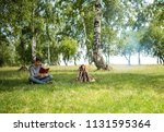 yellow tent camping. glade... | Shutterstock . vector #1131595364