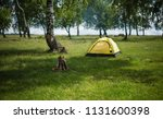 yellow tent on the nature.... | Shutterstock . vector #1131600398