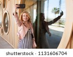 beautiful young tourist solo...   Shutterstock . vector #1131606704