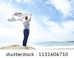 rear view of young woman...   Shutterstock . vector #1131606710