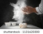 man clapping and sprinkling... | Shutterstock . vector #1131620300