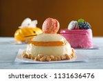 tasty mousse cake on wooden... | Shutterstock . vector #1131636476