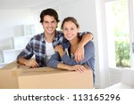 smiling couple leaning on boxes ... | Shutterstock . vector #113165296
