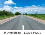 road through the green field... | Shutterstock . vector #1131654233