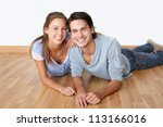 Cheerful Couple Laying Down...