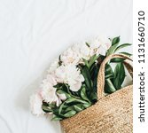 straw bag with white peony... | Shutterstock . vector #1131660710