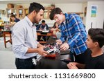 teacher with male pupils... | Shutterstock . vector #1131669800