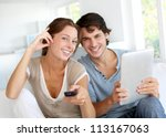 cheerful couple choosing tv... | Shutterstock . vector #113167063